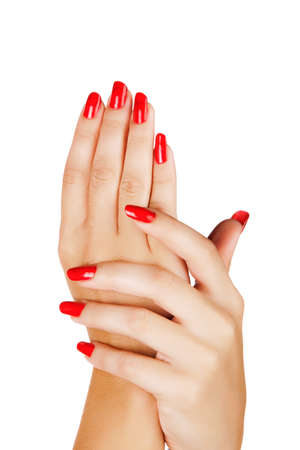 closeup of hands of a young woman with long red manicure on nails against white background Stock Photo - 13819937