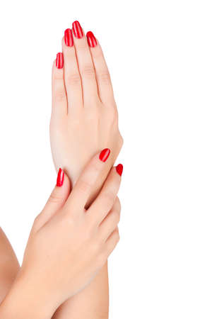 closeup of hands of a young woman with long red manicure on nails against white background Stock Photo - 13819896