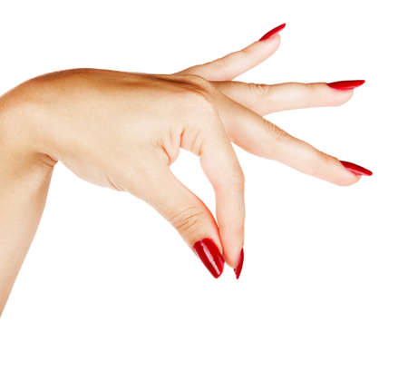 pinching: beautiful hand of a young woman with red manicure with fanned fingers as if holding something on white background