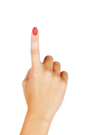 close-up of womans hand with red nails pointing with index finger on white background.
