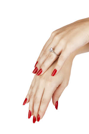 closeup hands of young woman with red manicure polished nails wearing an expensive engagement ring with a diamond Stock Photo - 13819843