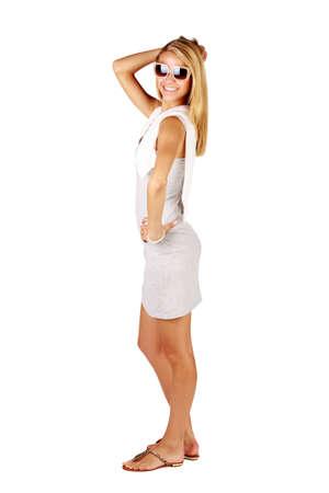 elegant blond beautiful woman wearing sunglasses and urban style modern summer mini dress on white studio background photo