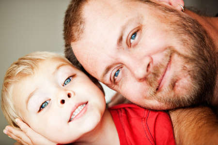 blue eyes happy father and toddler son closeup portrait - shallow depth of field, focus on child eyes Stock Photo - 14683790