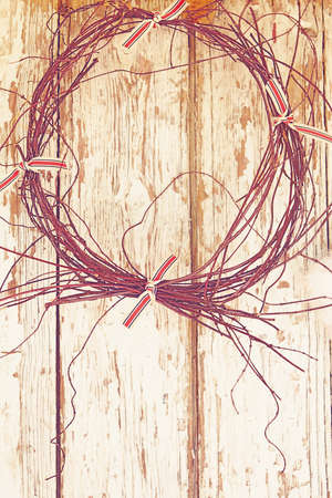 twigs wreath on a grunge wooden farm barn door with copy space   photo