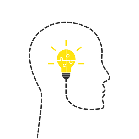Solution concept . Head and light bulb made of yellow puzzle pieces.