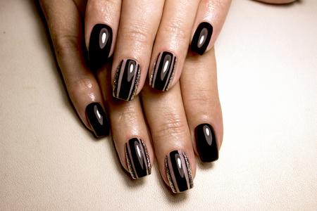 Black nail polish. Manicured nail with black nail polish. Manicure with dark nailpolish. Black nail art manicure Stock Photo