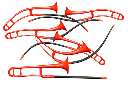 Six curved red trombones on the white background. are located chaotically.