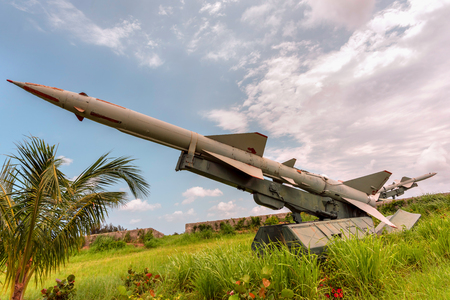 Military weapons, ballistic, anti-aircraft, medium-range missile complexes of ground-based in green grass, directed to the blue sky with white clouds. Stock fotó