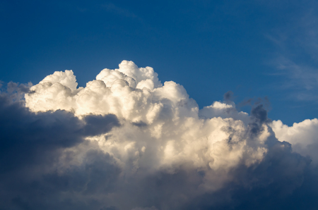fluffy white cumulus clouds against the blue sky after the rain