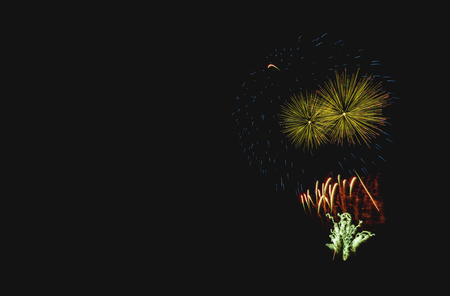 multicolored, clear fireworks on a black background isolated