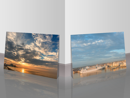 picture of a huge sky and sunset over the ocean and silhouettes of ancient buildings and a photograph of a cruise liner in the port, stand near the white wall and are reflected off the floor Reklamní fotografie