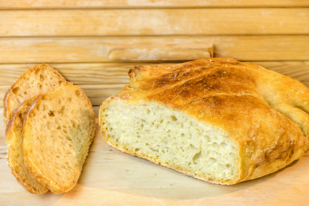 loaf of sliced white artisan bread, on the table near the breadbasket Stok Fotoğraf