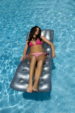 Water girl in pool on float photo