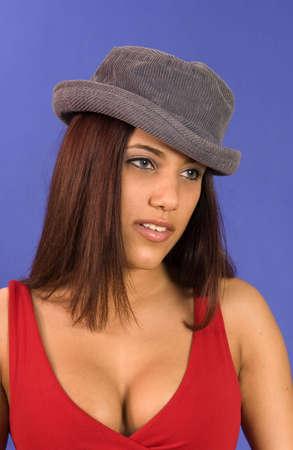Hispanic girl playing with hats making fun expresions