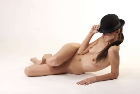 hat nude: Caucasian female posing nude with black hat Stock Photo