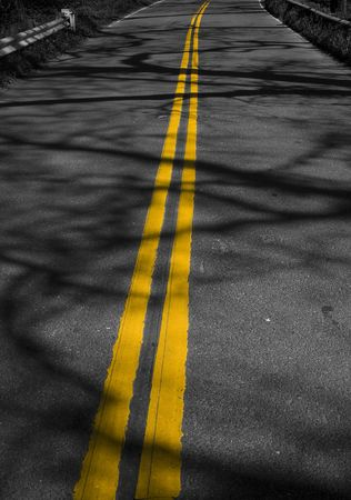 Abstract image of yellow lines on road with shadows Stock Photo - 6639796