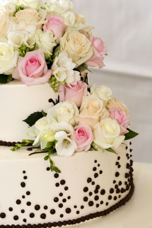 details of beautiful tiered wedding cake with flowers photo