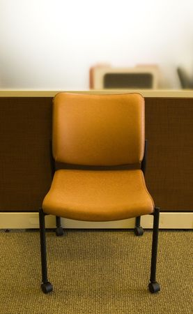 modern orange office chair against a cubicle Stock Photo - 6640142