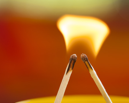 Two matches sharing a flame