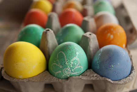 Colored Easter Eggs in cardboard carton Stock Photo