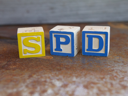 Sensory Processing Disorder (SPD) alphabet blocks Фото со стока