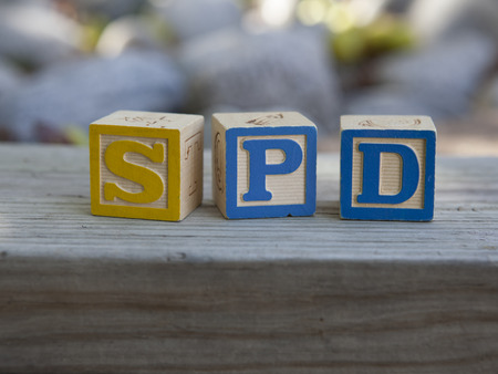 dysfunction: Sensory Processing Disorder (SPD) alphabet blocks Stock Photo