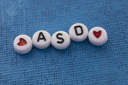 Autism Spectrum Disorder (ASD) spelled in craft beads Stock Photo