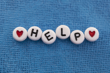 Help spelled in craft beads Stock Photo