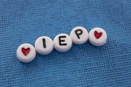 Individualized Education Plan IEP spelled in craft beads Stock Photo