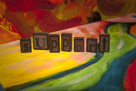 Support spelled in vintage blocks on canvas