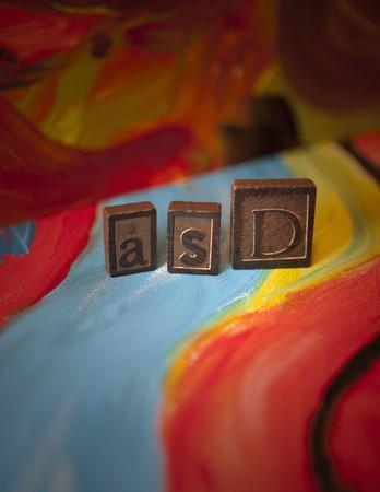 Autism Spectrum Disorder (ASD) blocks on canvas Stock Photo