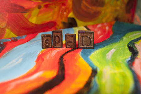 individualized: SPED spelled in vintage tiles on canvas Stock Photo
