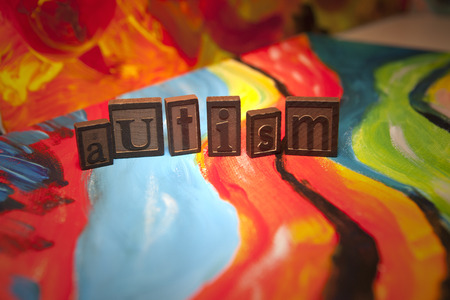 Autism spelled in vintage tiles on canvas Stock Photo
