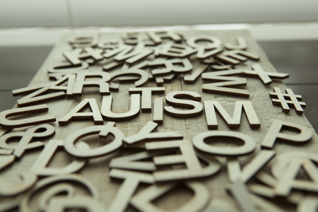 Autism spelled in wood letters