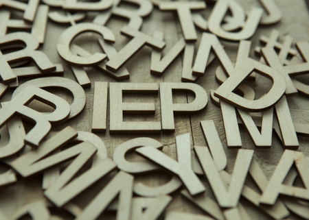 IEP (Individualized Education Plan) in a pile of wooden letters