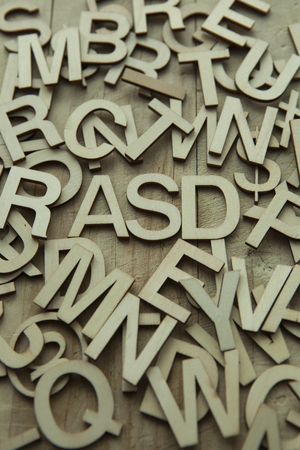 ASD (Autism spectrum disorder) in a pile of alphabet letters.