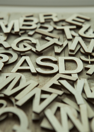 ocd: ASD (Autism spectrum disorder) in a pile of alphabet letters.