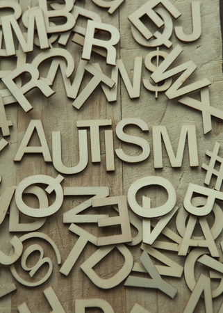 Autism spelled out in wood letters Stock Photo