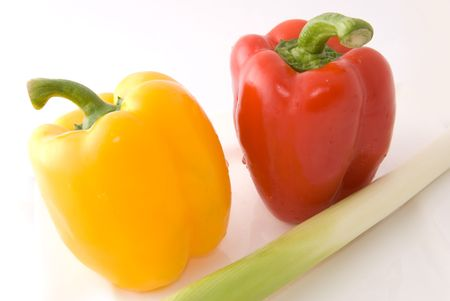 Capsicums and spring onion in lovely colors on white background, shot in studio photo