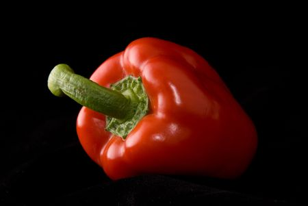 pimiento: Beautiful pimiento on black background, studio style