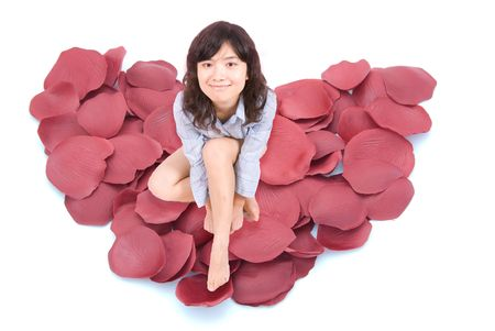 dispersed: Dispersed rose petal compose heart shape Stock Photo