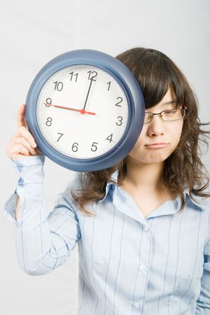 simply: Nine oclock is the working start time for a young office lady who is a bit relunct to work that day.
