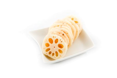 wholes: Fresh sliced lotus root in white plate
