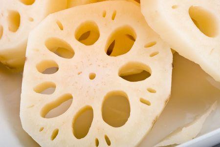 Fresh sliced lotus root in white plate