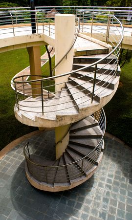 Modern outdoor spiral stair way in tropical area