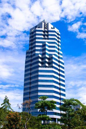 Modern single commercial building against blue sky photo