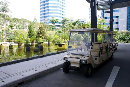 ourdoor: parking shuttle bus in tropical ourdoor park Stock Photo