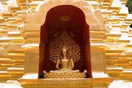 budda: Budda statue in golden building exterior in thailand Stock Photo