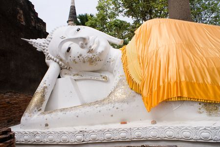 Lying buddha with golden cassock in thailand photo