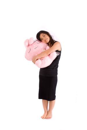 chinese girl standing with lovely pink doll Stock Photo - 3991391